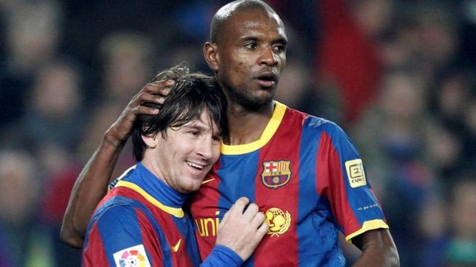 Eric Abidal (R) along with Lionel Messi.