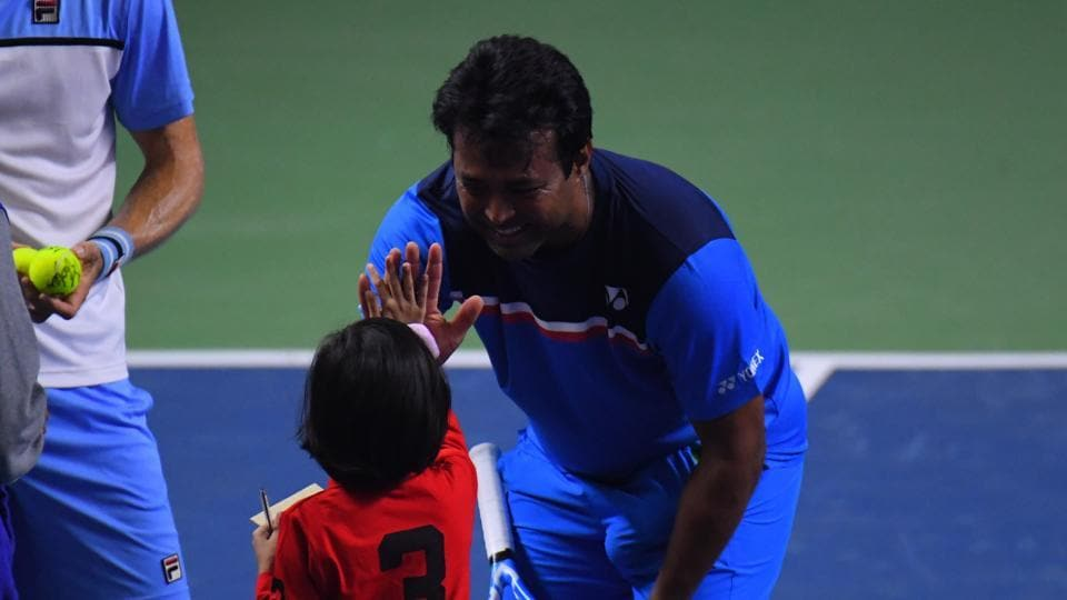 Indian tennis great Leander Paes with a young fan.