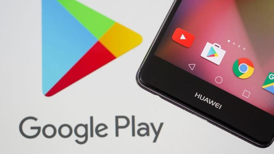 A Huawei smartphone is seen in front of displayed Google Play logo
