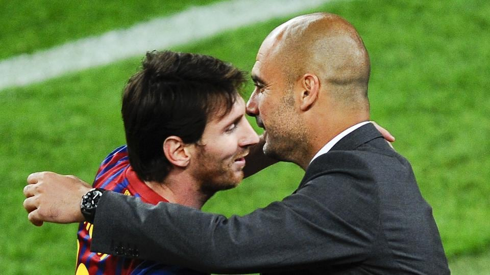 File image: Lionel Messi of FC Barcelona (R) shakes hands with Josep Guardiola