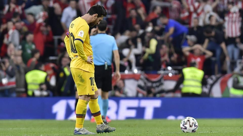 Barcelona's Lionel Messi stands in dejection at the end of the Spanish Copa del Rey.