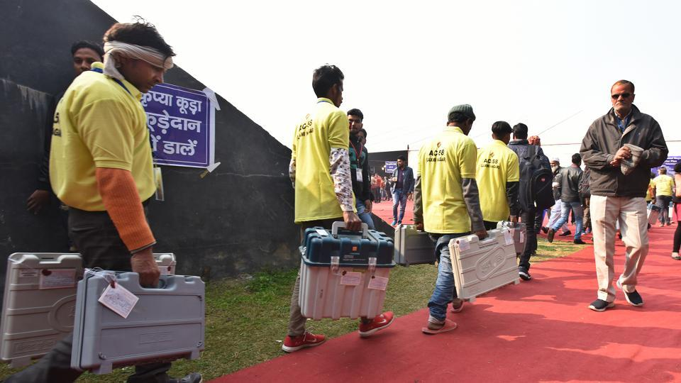 Polling officials with EVM machines as they collect and sort polling material ahead of the 2020 Delhi assembly elections