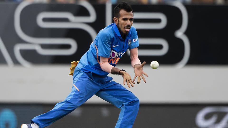 India bowler Yuzvendra Chahal prepares to catch out Mark Chapman off his own bowling.