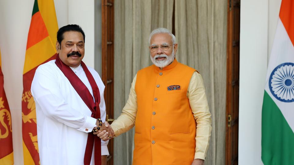 """Mr Rajapaksa sought to strike a balance between Sri Lanka's ties with India, and those with other regional players, such as China and Pakistan, describing India as a """"relation"""" and the others as friends"""