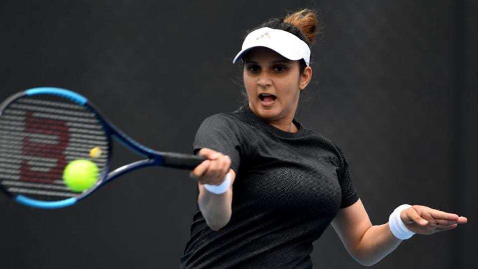 Sania Mirza of India plays a forehand shot.