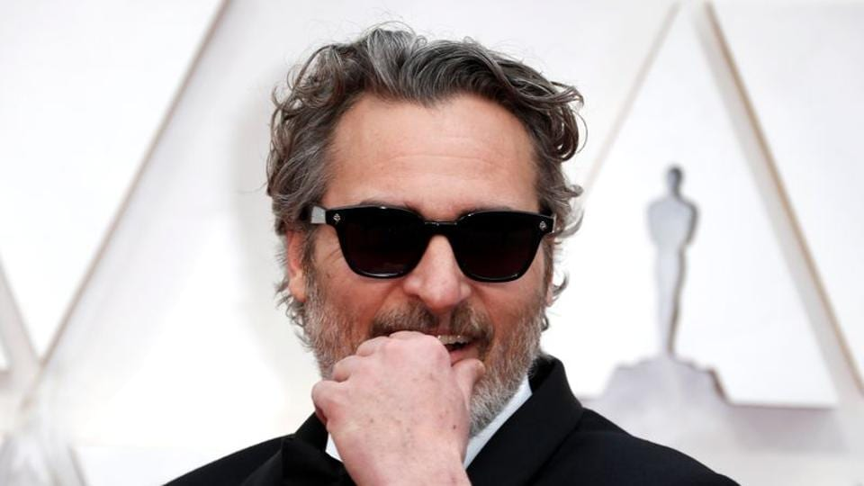 Joaquin Phoenix poses on the red carpet during the Oscars arrivals at the 92nd Academy Awards.