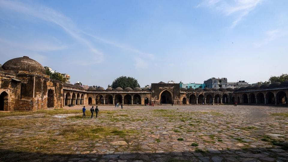 The Begampur mosque is one of the seven built by Khan-i-Jahan Junan Shah, who was 14th century ruler Feroze Shah Tughlaq's prime minister. The structure, which rises from a high plinth, consists of a large courtyard, enclosed by arched cloisters on the sides and a three-aisle deep prayer hall. The façade of the prayer hall is broken by 24 arched openings. (Amal KS / HT Photo)