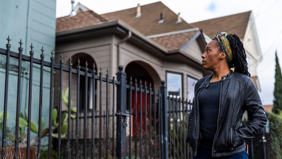 Dominique Walker surveys a vacant home in Oakland, California. When Walker moved back from Mississippi to her native California last year, she planned to pursue a nursing degree while caring for her children. But she and other moms and their children ended up living as squatters in a bold protest against homelessness. (Philip Pacheco / AFP)