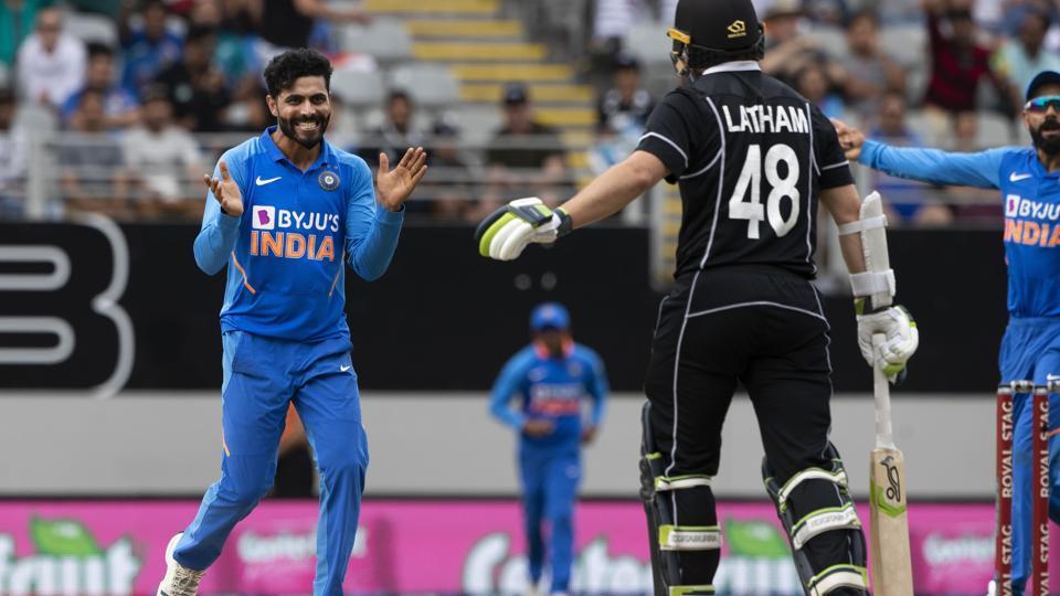 Indian bowler Ravindra Jadeja, left, celebrates the wicket of Black Caps captain Tom Latham (48) during a One Day International cricket between India and New Zealand at Eden Park in Auckland, New Zealand, Saturday, Feb 8, 2020. (Brett Phibbs/Photosport via AP)