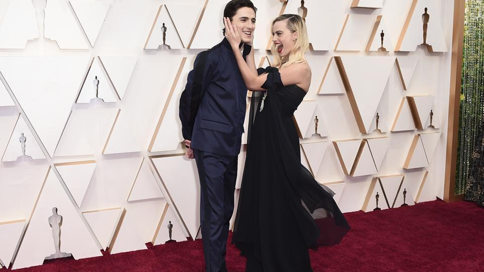 Timothee Chalamet, left, and Margot Robbie arrive at the Oscars on Sunday, Feb. 9, 2020, at the Dolby Theatre in Los Angeles. (Photo by Jordan Strauss/Invision/AP) (Jordan Strauss/Invision/AP)