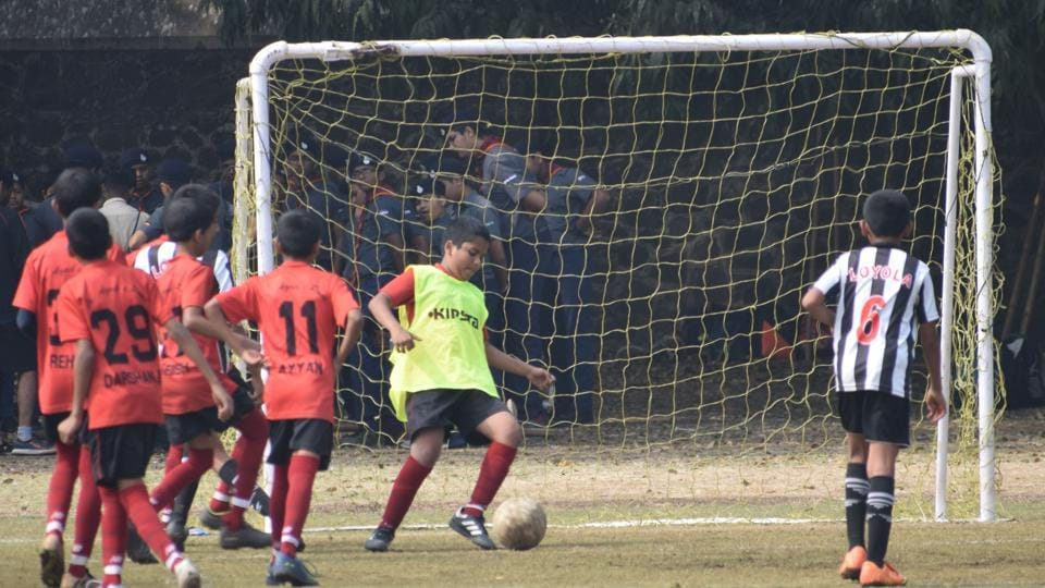 Players of Vidyankur School (red) and Loyola School (black and white) in action during the inaugural St Vincent's junior league inter-school (U-12) football tournament played at St Vincent's High School football ground on Saturday.
