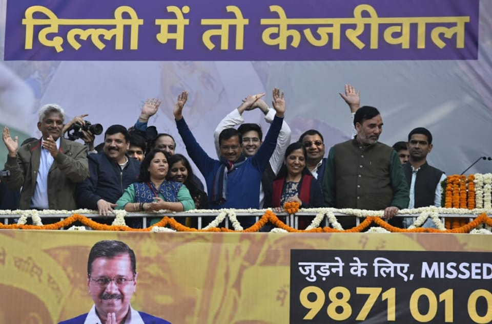 Arvind Kejriwal, his wife Sunita Kejriwal and party workers during a media address at AAP's office at Rouse Avenue, New Delhi.