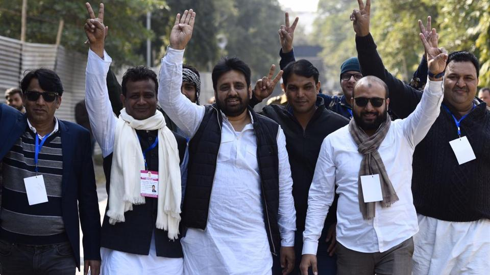 AAP candidate Amanatullah Khan from the Okhla assembly constituency displays the victory sign along with his supporters at the Maharani Bagh counting centre in New Delhi.
