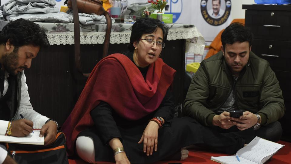 Aam Aadmi Party candidate from Kalkaji constituency Atishi interacts with party workers, in this file photo.