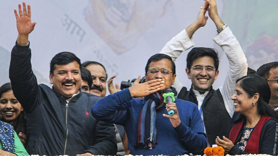 New Delhi: Delhi CM and AAP convenor Arvind Kejriwal (C) gestures during his address to supporters after party's victory in the State Assembly polls, at AAP office in New Delhi, Tuesday, Feb. 11, 2020. Kejriwal's wife Sunita, and party leaders Sanjay Singh are also seen. (PTI Photo)(PTI2_11_2020_000241B)