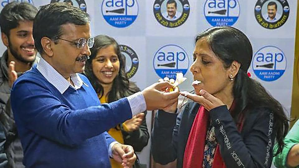 Delhi Chief Minister and AAP chief Arvind Kejriwal offers cake to wife Sunita Kejriwal as they celebrate her birthday, at the party headquarters in New Delhi on Tuesday.