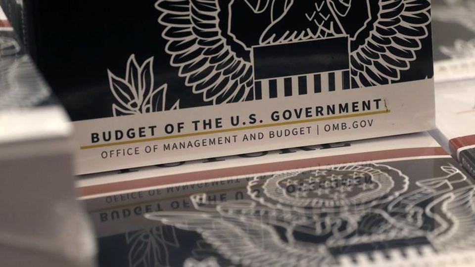 Copies of U.S. President Donald Trump's FY2021 budget proposal sit on display for the news media on Capitol Hill in Washington, US.
