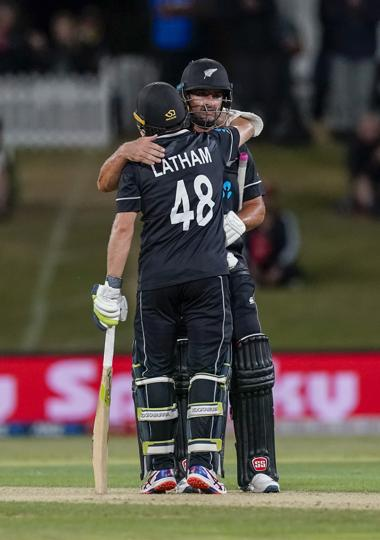 New Zealand's Colin de Grandhomme and Tom Latham celebrate the win during the One Day cricket international between India and New Zealand at Bay Oval, Tauranga, New Zealand, Tuesday, Feb. 11, 2020. (John Cowpland/Photosport via AP) (AP)