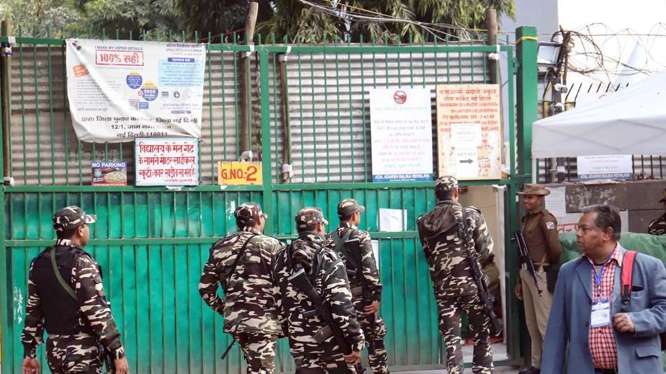 Security personnel are seen outside counting centres ahead of the Delhi assembly election result, at Gole Market.