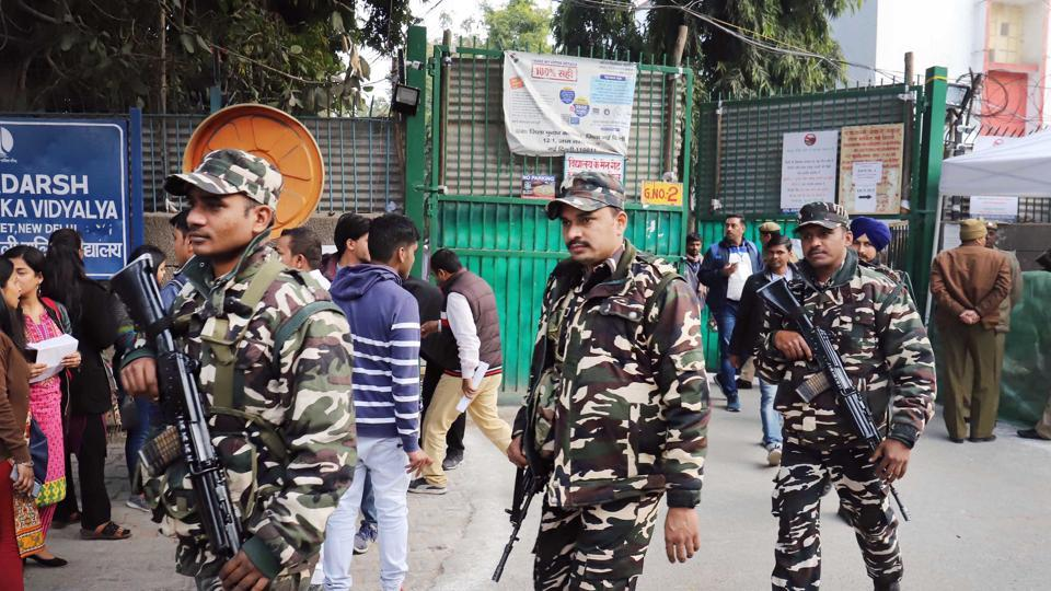 Security personnel are seen outside counting centres ahead of the Delhi assembly election result, at Gole Market, in New Delhi.
