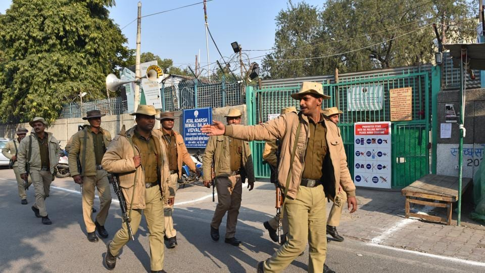 Security personnel are seen outside counting centres ahead of the Delhi assembly election result.
