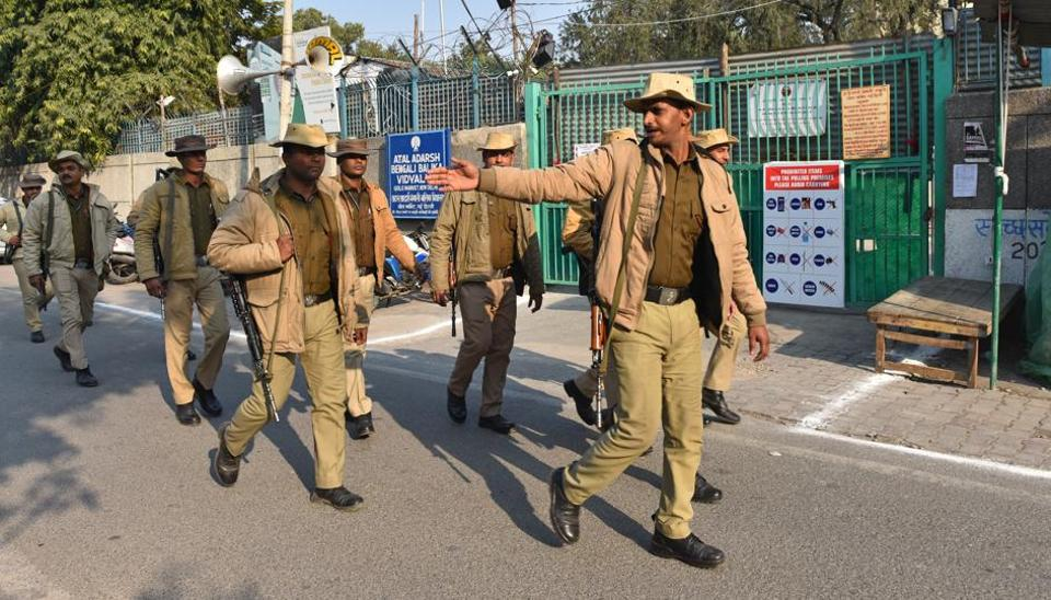 Security personnel are seen outside counting centres ahead of the Delhi assembly election result, at Gole Market, in New Delhi, India, on Monday, February 10, 2020.
