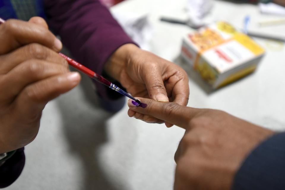 New Delhi, India- Feb 08, 2020: A poll official marks a voter's finger with indelible ink during Delhi Assembly Election polling at Yamuna Vihar in North East Delhi, India on Saturday, February 08, 2020. (Photo by Sonu Mehta/Hindustan Times)