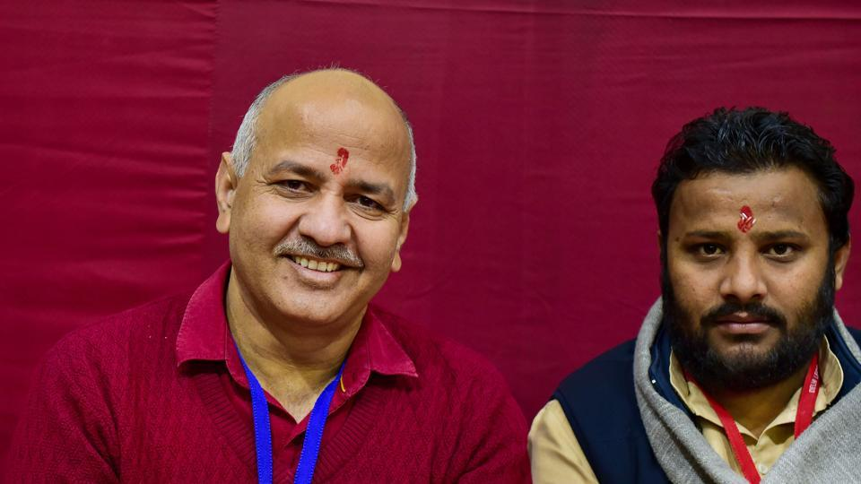 Delhi Deputy Chief Minister Manish Sisodia and AAP candidates are seen at Akshardham centre, during counting of votes for the Delhi Assembly poll results.