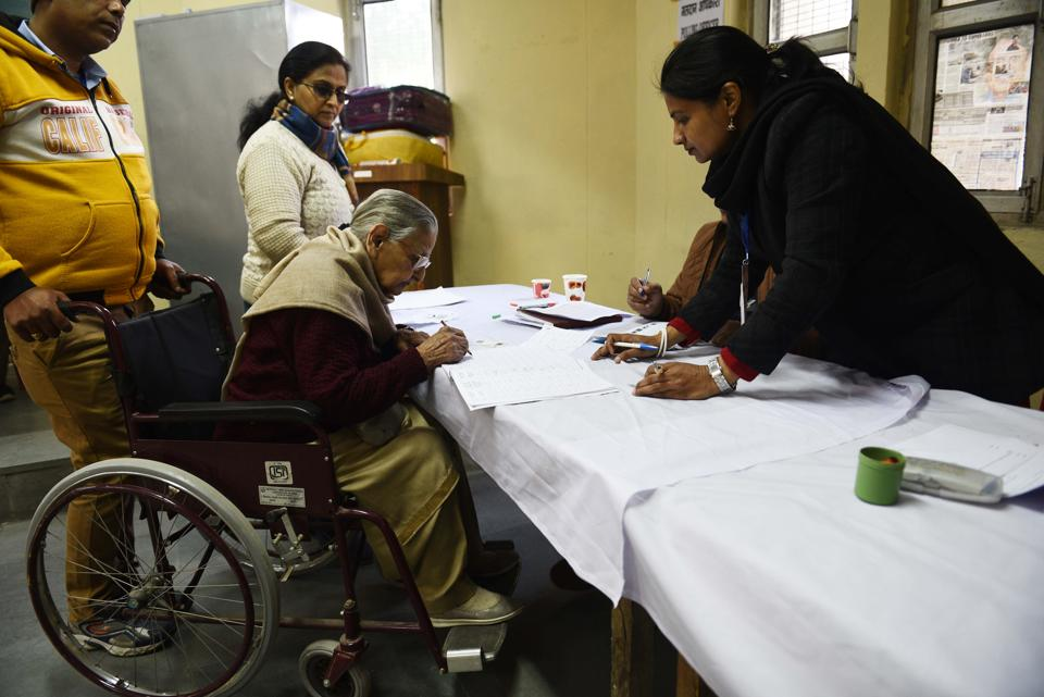 New Delhi, India - February 8, 2020: An elderly woman on a wheelchair casts her vote during Vidhan Sabha elections, at Sector 7, Dwarka, in New Delhi, India, on Saturday, February 8, 2020. (Photo by Vipin Kumar / Hindustan Times)