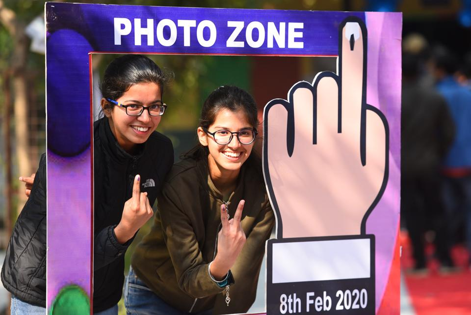 New Delhi, India - February 8, 2020: First-time voters Himani Sharma and Priyanka show their fingers marked with indelible ink after casting their votes during Vidhan Sabha elections, at Khyber Pass, in New Delhi, India, on Saturday, February 8, 2020. (Photo by Raj K Raj / Hindustan Times)