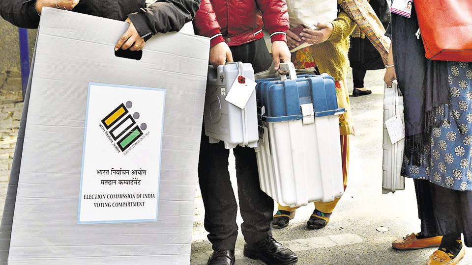 New Delhi, India - February 7, 2020: Electoral officials carry Electronic Voting Machines (EVM) and Voter Verifiable Paper Audit Trail (VVPAT) while heading towards their respective centre ahead of Delhi Vidhan Sabha elections, at Gole Market Distribution Centre, in New Delhi, India, on Friday, February 7, 2020. (Photo by Vipin Kumar / Hindustan Times)