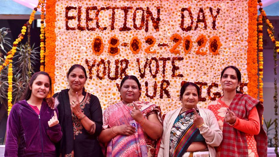 Women show their finger marked with indelible ink after casting their votes during the Delhi Assembly election at Narela in New Delhi, India, on Saturday, February 8, 2020.