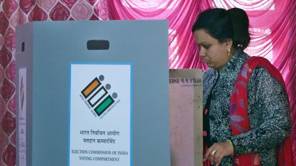 A woman casts her vote during the Delhi Assembly election at Narela in New Delhi, India, on Saturday, February 8, 2020.