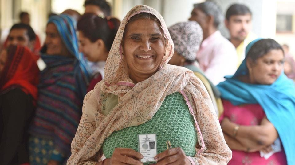 A woman shows her voter id card before casting her vote during the Delhi Assembly election at Narela in New Delhi, India, on Saturday, February 8, 2020.