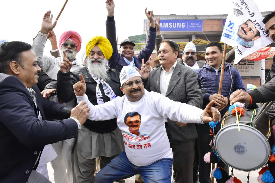 Aam Aadmi Party workers celebrating the party's success in Delhi assembly polls at the party office in Amritsar on Tuesday.