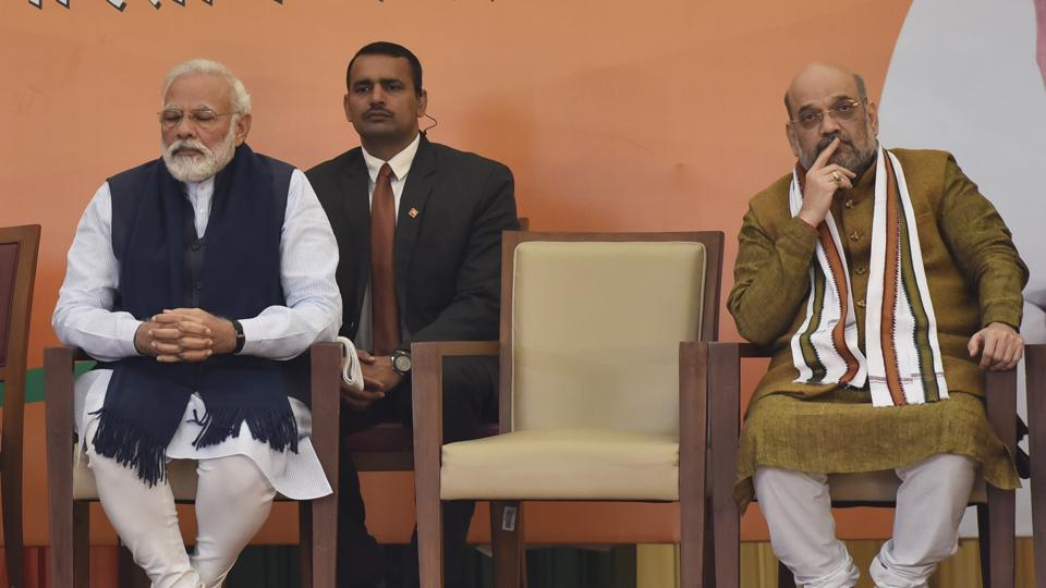 Prime Minister Narendra Modi and Union Home Minister Amit Shah listen to newly elected Bharatiya Janata Party (BJP) president J.P.Nadda at BJP headquarters.