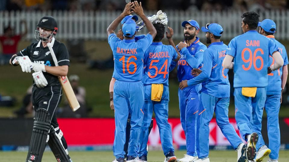 India celebrate the wicket of New Zealand's Henry Nicholls, left, during the One Day cricket international between India and New Zealand at Bay Oval, Tauranga, New Zealand, Tuesday 11 Feb 2020. (John Cowpland/Photosport via AP)