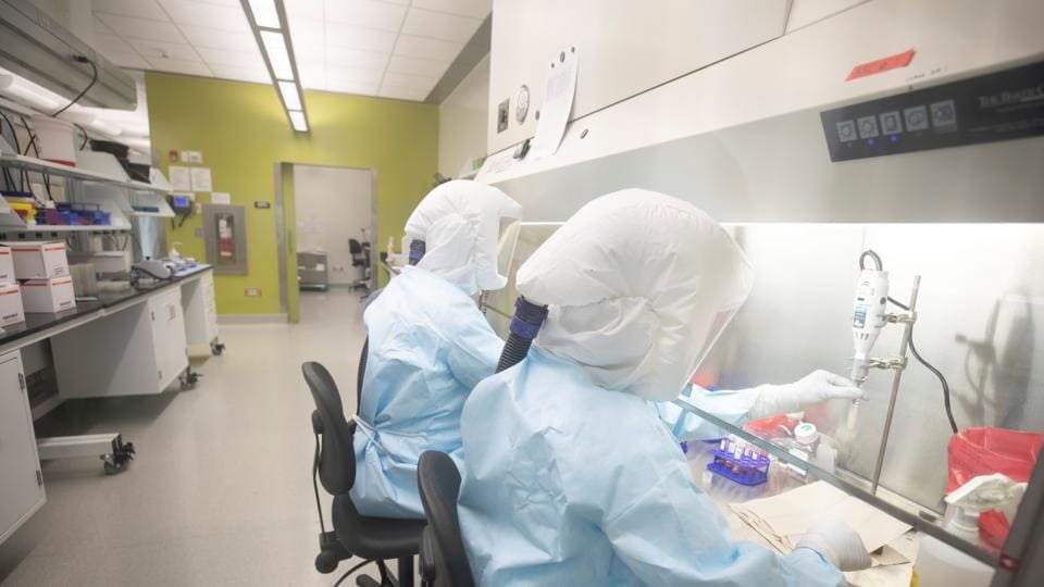 Scientists work in VIDO-InterVac's (Vaccine and Infectious Disease Organization-International Vaccine Centre) containment level 3 laboratory, where the organization is currently researching a vaccine for novel coronavirus, at the University of Saskatchewan in Canada.