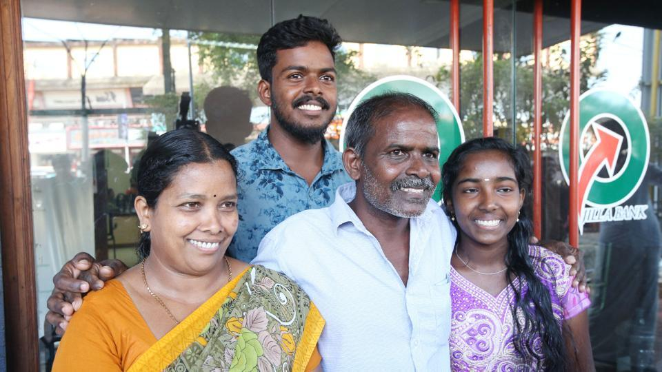 PRajan  with his family after winning a bumper prize of Rs 12 crore in a Kerala state lottery.