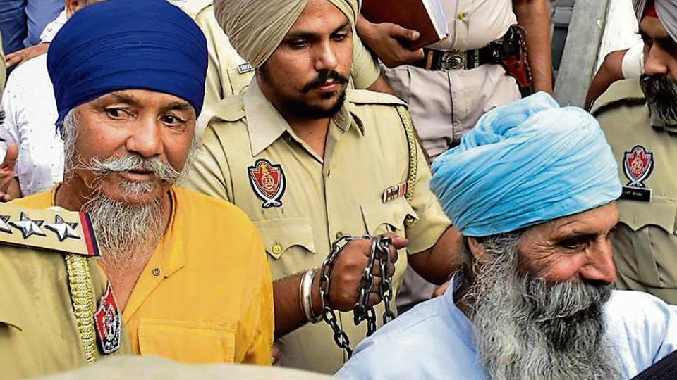 Punjab Police personnel taking accused Balbir Singh and Harbhajan Singh to court in Amritsar on September 23, 2019. Nine people have been arrested in the case so far.