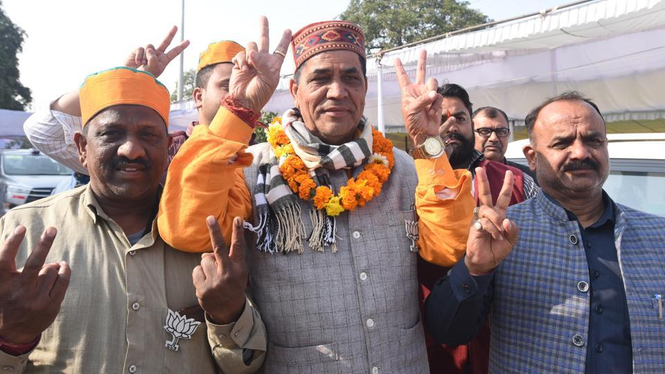 Mohan Singh Bisht, Bharatiya Janata Party (BJP) candidate from Karawal Nagar, and his supporters show victory signs after his win in the Delhi Legislative Assembly election 2020, while leaving the Industrial Training Institute (ITI) counting centre, Nand Nagri, in New Delhi, India, on Tuesday, February 11, 2020.