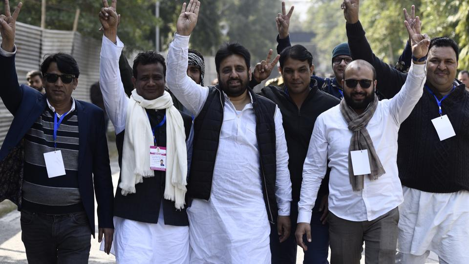 AAP candidate Amanatullah Khan from Okhla constituency shows the victory sign along with his supporters outside Maharani Bagh counting centre.