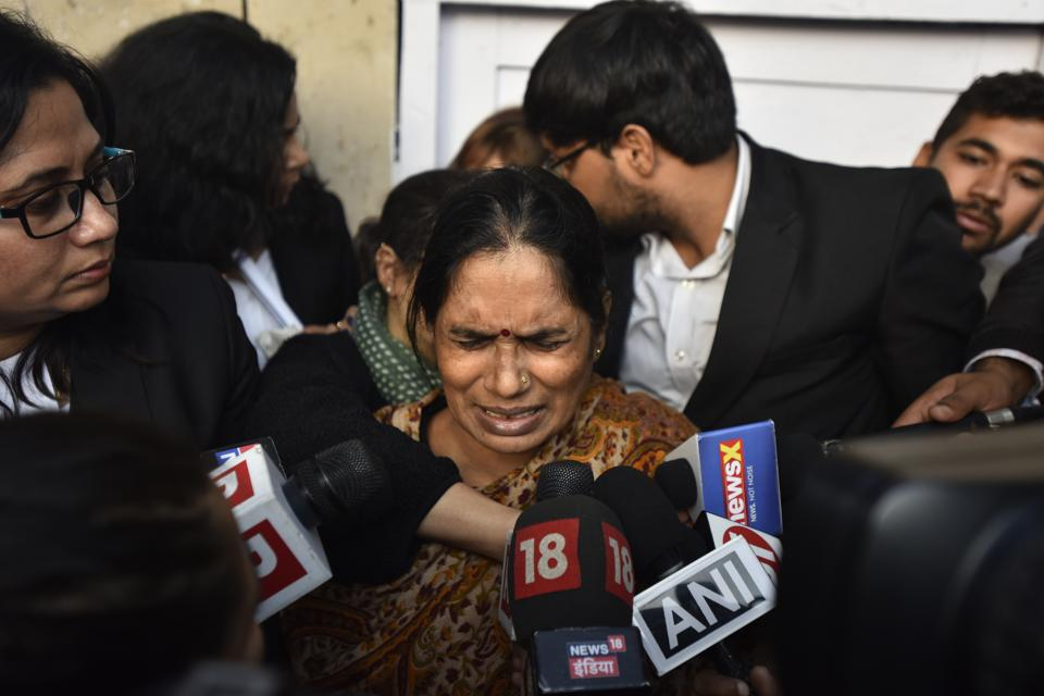 Asha Devi, mother of the victim, breaks into tears at Patiala House Court in New Delhi.