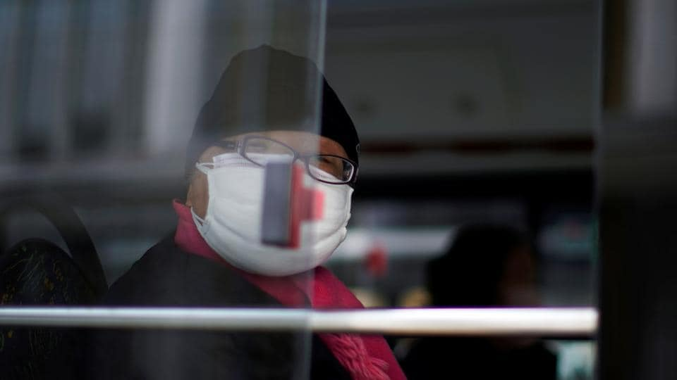 A man wearing a mask is seen on a bus, in downtown Shanghai, China, as the country is hit by an outbreak of a new coronavirus, February 12, 2020.