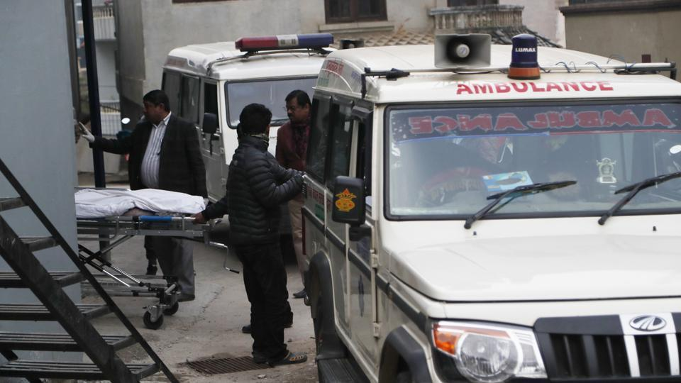 Hospital staff load bodies of Indian tourists into an ambulance for postmortem, at a hospital in Kathmandu, Nepal on Jan. 21, 2020. Eight Indian tourists were declared dead after being found unconscious in their room at a mountain resort in Nepal, police said.