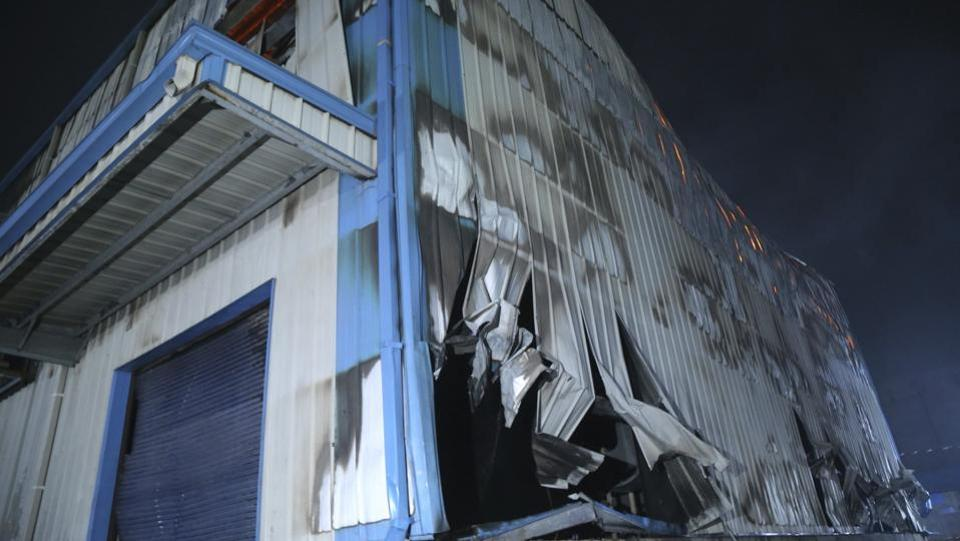 "Damage after a fire broke out at Nandan Denim, in Ahmedabad. ""Smoke kept billowing from the building as workers trapped inside screamed for help,"" one eyewitness who spoke on condition of anonymity to AP, because he was worried he'd lose his job. The fire broke out Saturday in its two-story factory on the outskirts of Ahmedabad. (AP Photo)"