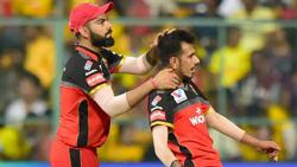 RCB bowler Yuzvendra Chahal and Virat Kohli celebrate after claiming the wicket.