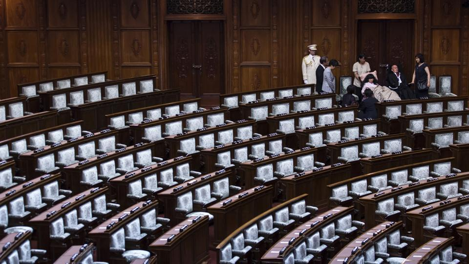 "The upper house is paying for Kimura and Funago's assistants, but the new lawmakers want rules changed to help the 11,500 other seriously disabled people who rely on public care. Both use special reclined chairs in the chamber. They have faced some criticism, with a tweet declaring their presence in parliament ""a nuisance"" that would impede speedy deliberations drawing 49,000 likes and 23,000 retweets. (Tomohiro Ohsumi / Getty Images)"