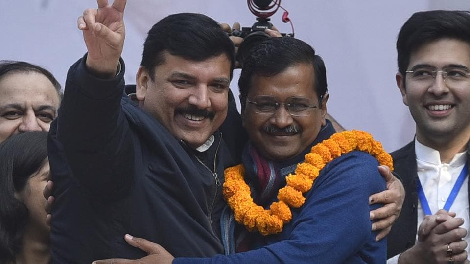 Delhi Chief Minister Arvind Kejriwal hugs party leader Sanjay Singh after party's victory in Delhi Assembly Election.