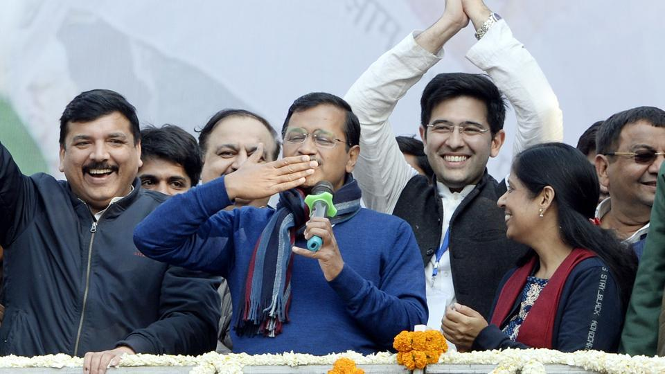 Delhi CM and AAP convenor Arvind Kejriwal (C) gestures during his address to supporters after party's victory in the Delhi polls. (PTI photo)